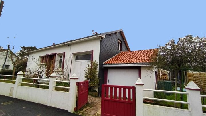Estimatif du montant des travaux d'extension et surélévation du garage d'une maison à Nantes
